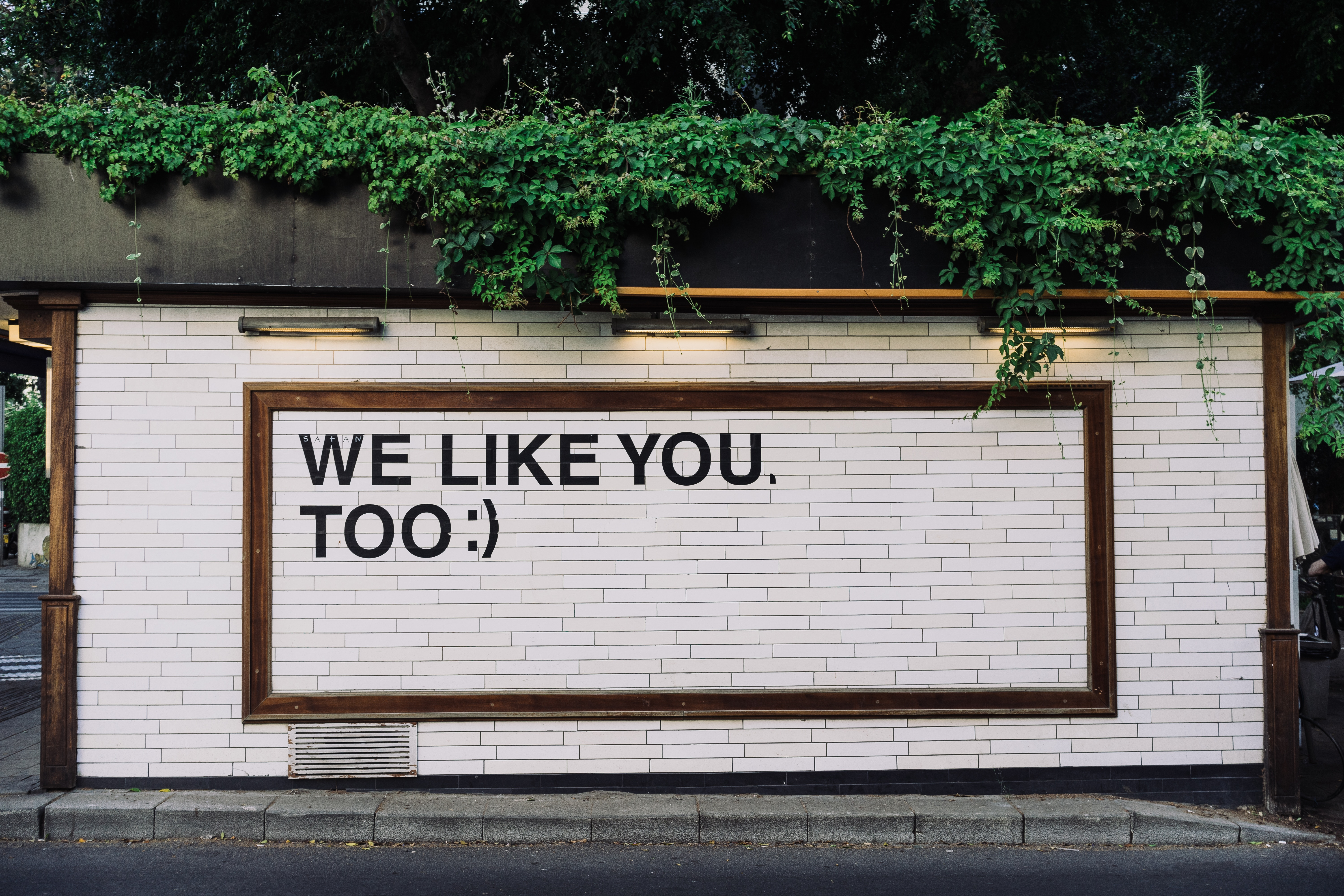 Side of a building with the words: We like you too.