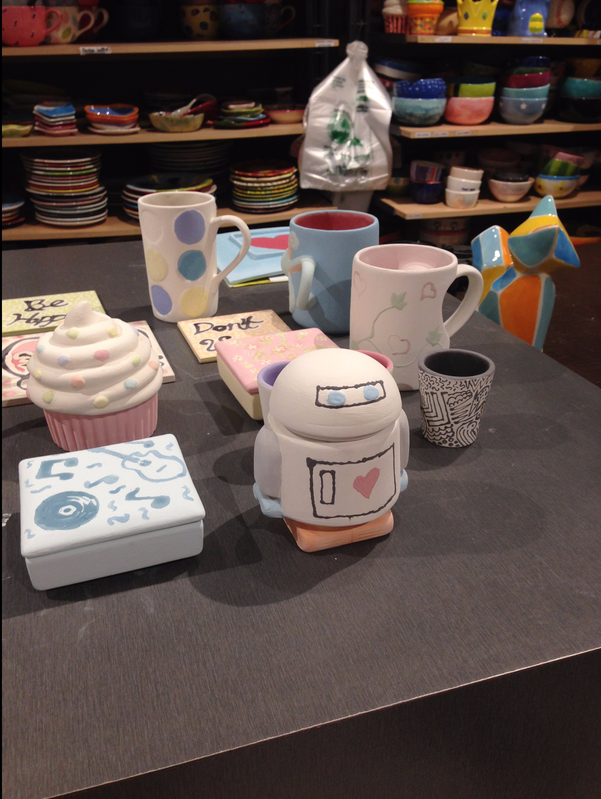 A collection of ceramics (mugs, cupcakes, robots and more).